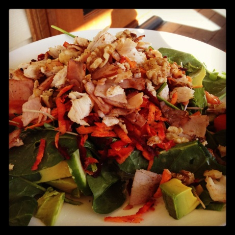 Chicken Caesar salad. Spinach, sprouts, avocado, grated beetroot and carrot, cucumber, chicken, bacon, walnuts, lemon juice, olive oil.